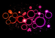 Abstract Glowing Circles of light with rainbow colors background. Stock Photo