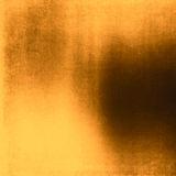 Abstract gold background brown frame bright spotlight smooth vin Royalty Free Stock Photography