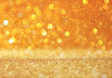 Abstract gold background with copy space . gliiter bokeh lights. Royalty Free Stock Photography