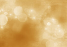 Abstract gold background luxury Christmas holiday, wedding backg. Round brown frame bright spotlight smooth vintage bokeh texture gold paper layout design bronze Royalty Free Stock Photo