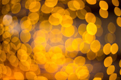 Abstract gold bokeh background circles for Christmas card. Royalty Free Stock Photo