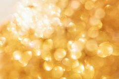 Abstract gold Bokeh background, bright light from corner. Abstract gold Bokeh backgrounds , bright light from corner Stock Photo