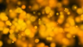 Abstract gold bokeh with black background Stock Photography