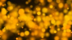 Abstract gold bokeh with black background Royalty Free Stock Photos