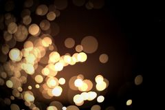 Abstract gold bokeh with black background. For festive season Royalty Free Stock Photos