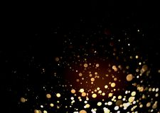 Abstract gold bokeh with black background. For festive season Stock Photo