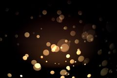 Abstract gold bokeh with black background. For festive season Stock Photography
