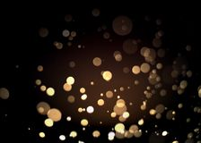Abstract gold bokeh with black background. For festive season Royalty Free Stock Photography