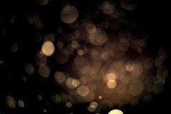 Abstract gold bokeh with black background. For festive season Stock Photos