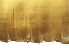 Free Abstract Gold Bronze Glittering Color Surface. Paint Smear Brush Stroke Stain Texture Royalty Free Stock Image - 194077176