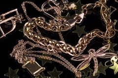 Abstract gold chain, braclet and jewerly on a dark background royalty free stock photos