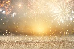 Abstract gold glitter background with fireworks. christmas eve, new year and 4th of july holiday concept. Abstract gold glitter background with fireworks royalty free stock images