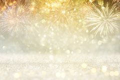 Abstract gold glitter background with fireworks. christmas eve, new year and 4th of july holiday concept. Abstract gold glitter background with fireworks stock photo