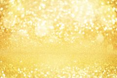 Abstract gold glitter bokeh lights with soft light background