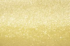 Abstract gold glitter bokeh lights with soft light background.  royalty free stock photo
