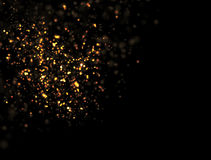 Abstract Gold Glitter Explosion. On Black Background Stock Image