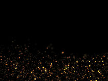 Abstract Gold Glitter Explosion. On Black Background Royalty Free Stock Photography