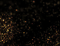 Abstract Gold Glitter Explosion. On Black Background Stock Photos