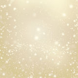Abstract Gold glittering christmas lights - Blurred  background Stock Images