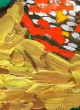 Abstract gold oil painting. A close up of an abstract oil painting with gold and red colors Stock Photo