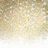 Abstract gold paper background with multicolored confetti Royalty Free Stock Photo