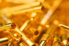 Abstract gold pins close-up Stock Photos