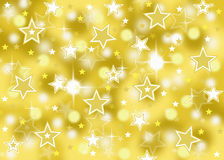 Abstract gold star bokeh celebration background with sparkles Royalty Free Stock Photo
