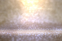 Abstract gold violet background with glittering bokeh Royalty Free Stock Photos