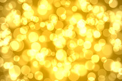 Abstract golden background. Abstract bokeh lights on golden colored background Royalty Free Stock Photo