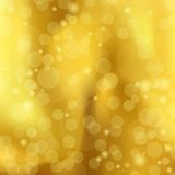 Abstract a golden background with Bokeh, vector Stock Images
