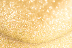 Abstract golden background with bright bokeh effects. For a festive wedding concept stock images