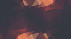 Abstract golden background consisting of triangles. Royalty Free Stock Photo