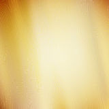 Abstract golden background with texture. A pattern of lines and curves. The folds of fabric Stock Photography