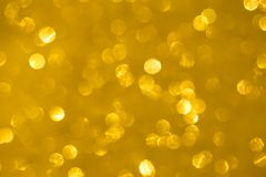 Abstract golden bokeh texture royalty free stock photography