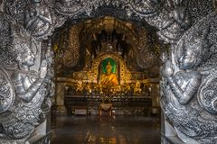 Abstract golden Buddha statue with silver metal frame in temple. At Wat Sri Suphan Chiang Mai, Thailand Stock Images