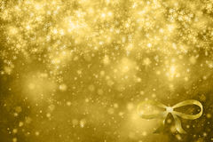 Abstract golden Christmas Holiday background with ribbon Stock Photography