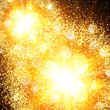 Abstract golden explosion with gold glitter. Stock Photos