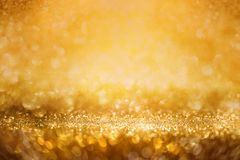 Abstract golden glitter bokeh background Royalty Free Stock Images