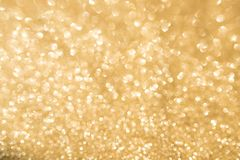 Abstract golden glitter bokeh background Stock Photo