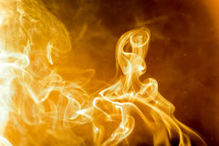 Abstract golden heat smoke. The smoke was burning. Abstract golden heat Stock Photos