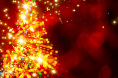 Abstract golden light christmas tree on red background