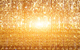 Abstract golden light reflex. On crystal daimond for background royalty free stock photos