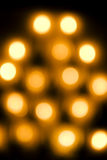Abstract golden orange lights. Round abstract golden orange lights with dark background stock photography