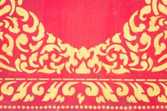 Abstract golden pattern on red wall Royalty Free Stock Image