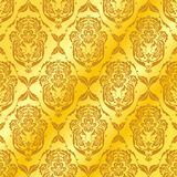Abstract golden patterns. Graceful patterns on a golden background Stock Images
