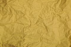 Abstract crumpled paper. Abstract golden recycle crumpled paper for background Stock Photography