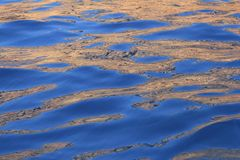 Abstract golden reflection blue water shapes Royalty Free Stock Images