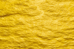 Abstract golden rough cement texture background stock images