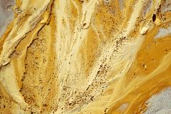 Golden sand texture on the beach. Abstract golden sand texture on the beach, closeup view royalty free stock photo