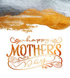 Abstract golden and silver background with a brush of acrylic paint on paper and text Happy mothers day. Calligraphy Royalty Free Stock Images
